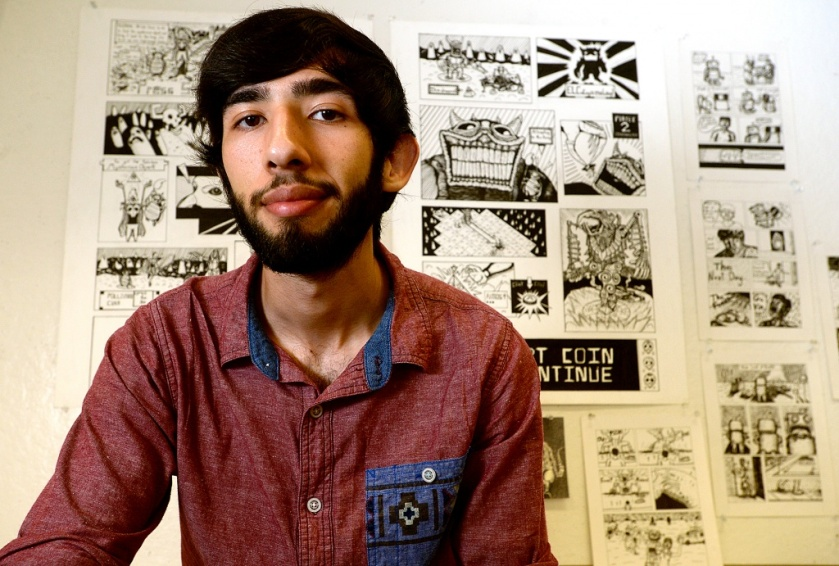 Gonzalo Alvarez, a local artist and member of 3C Comics - a collective of comic book artists, combines elements of his Hispanic culture with a love of wry humor and macabre art in his work. A second year art student at Lamar University, he has a showing of his pieces at the art museum in Nacogdoches and sells prints locally, as well.  Photo taken Tuesday, October 13, 2015 Kim Brent/The Enterprise
